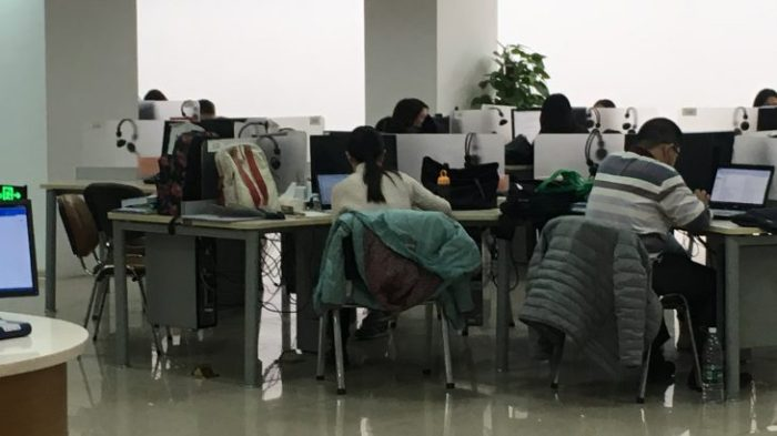 students studying at computers in computer lab
